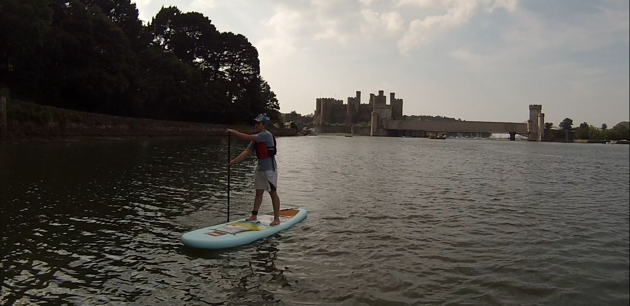 Torin Paddleboarding by Conwy Castle